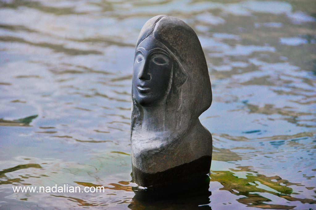 Ahmad Nadalian, sculptures, Stone, installed in river, Goddess of Water