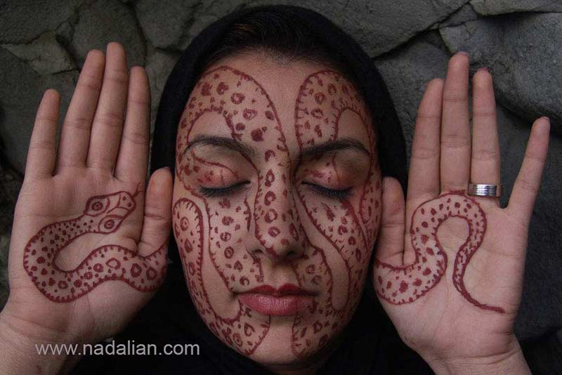 Design on the face of girls by red earth of Hormuz Island 2007