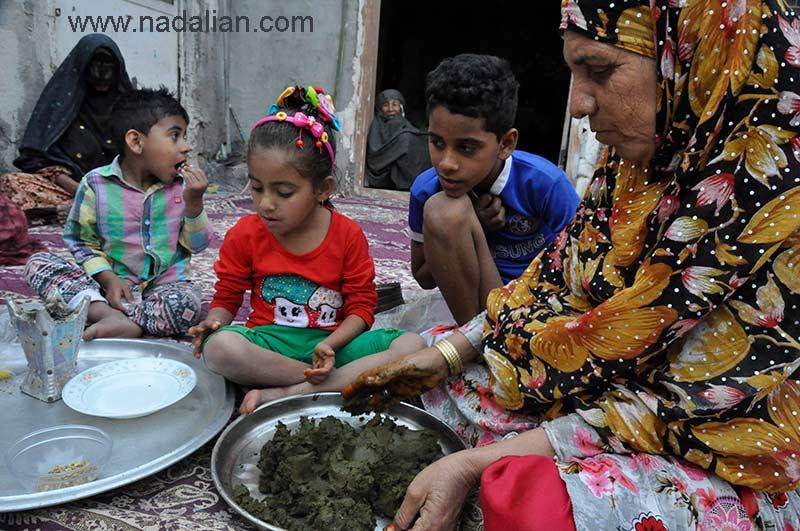 Preparing henna for the wedding ceremony, Hormoz Island