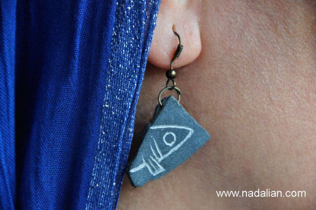 Stone earrings inspired by destroyed art works of Ahmad Nadalian in nature