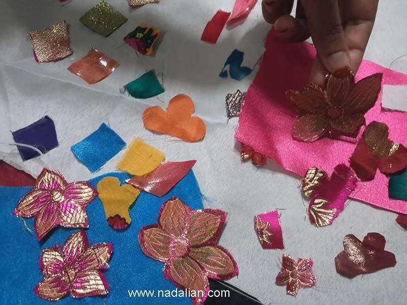 به دختران آموزش داده شد که برای انجام پارچه نقاشی پشت شیشه از پارچه های اضافه دوخت لباس و کهنه استفاده شود.